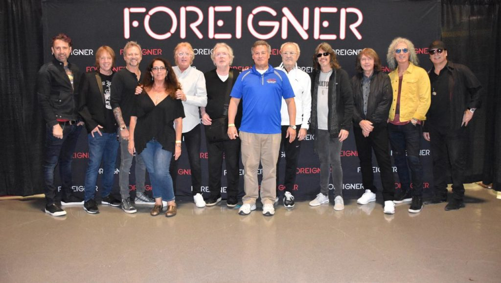 This photo contains both the original and newer members of Foreigner Band - a rare photo op...